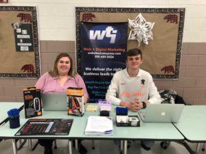 Team WTI staff members at eighth grade career fair